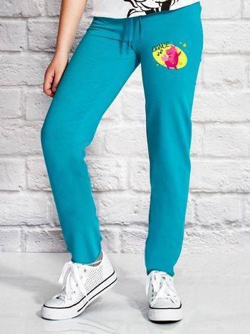 Spodnie dresowe dla dziewczynki z konikiem zielone
