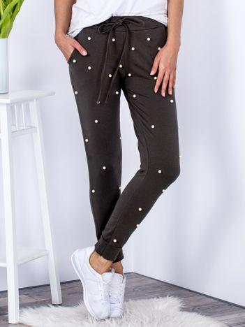 Spodnie dresowe khaki ze ściągaczami i perełkami