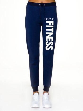 Spodnie dresowe z napisem FOR FITNESS z przodu granatowe