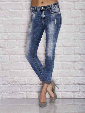 Spodnie jeansowe dekatyzowane z przetarciami niebieskie