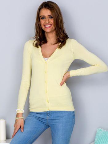 Sweter żółty na guziki