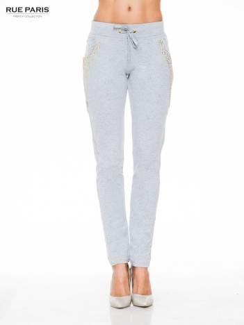 Szare eleganckie spodnie dresowe z dżetami