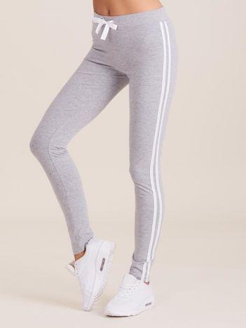 Szare spodnie dresowe damskie z lampasami