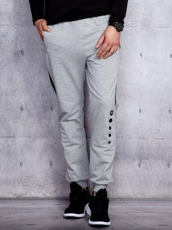 Szare spodnie dresowe męskie z kontrastowymi modułami