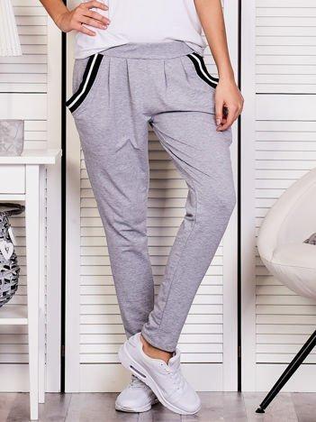 Szare spodnie dresowe ze ściągaczami przy kieszeniach