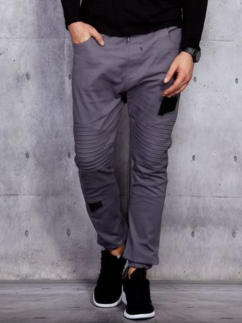 Szare spodnie joggery męskie z przeszyciami i łatami