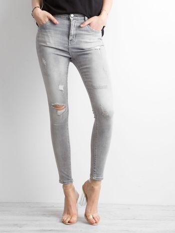 Szare spodnie skinny z przetarciami