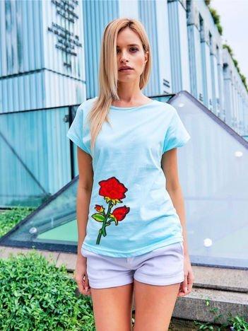 T-shirt damski turkusowy z naszywką cekinową DUŻY KWIAT