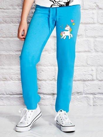 Turkusowe spodnie dresowe dla dziewczynki z motywem jednorożca