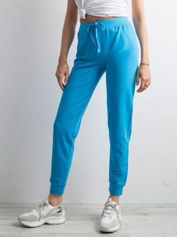 Turkusowe spodnie dresowe z troczkami