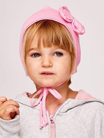 Wiązana czapka dziewczęca z ozdobną kokardą jasnoróżowa