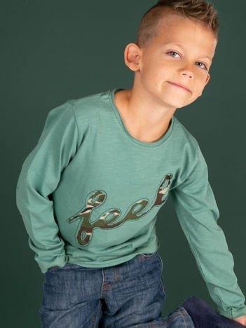 Zielona bawełniana bluzka dziecięca z moro aplikacją