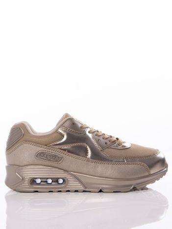 Złote buty sportowe z poduszką powietrzną i ażurową wstawką na przodzie cholewki