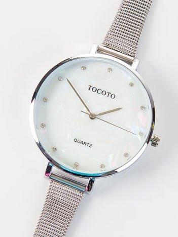 Złoty zegarek damski z perłową tarczą i z cyrkoniami na bransolecie MESH