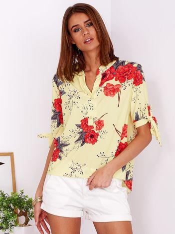 Żółta bluzka w kwiaty z guzikami i wiązaniami