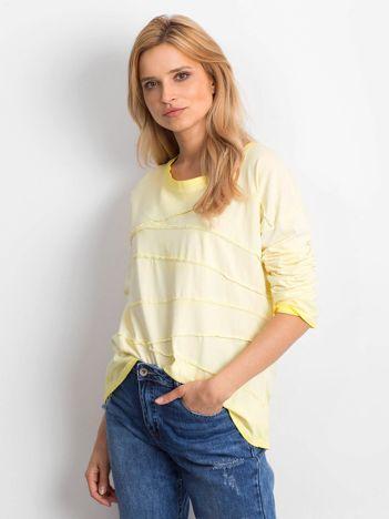 Żółta bluzka z asymetryczymi przeszyciami