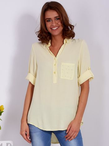 Żółta bluzka z perełkami na kieszonce