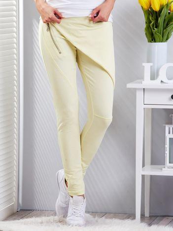Żółte spodnie dresowe z suwakami