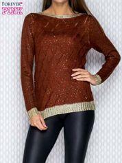 Ażurowy sweter brązowy ze złotym wykończeniem