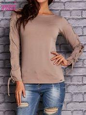 Beżowa bluzka z wiązaniem na rękawach