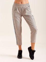 Beżowe spodnie w kratkę