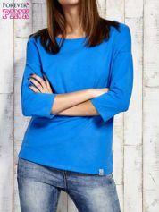 Bluzka oversize ze skrzyżowaniem na plecach niebieska