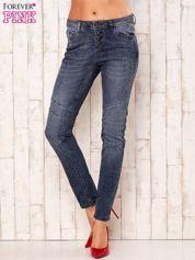 Ciemnoszare spodnie jeansowe z przeszyciami