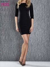 Czarna sukienka tuba ze skórzanymi modułami