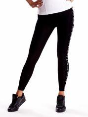 Czarne legginsy z napisami