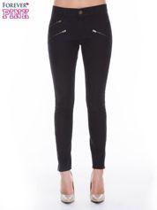 Czarne spodnie jeansowe typu skinny z suwakami