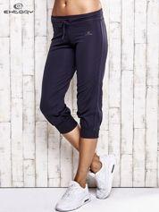 Grafitowe spodnie damskie capri z troczkami