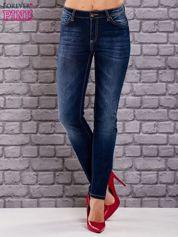 Granatowe jeansy slim z wysokim stanem