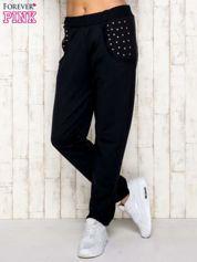 Granatowe spodnie dresowe z napami