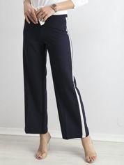 Granatowe szerokie spodnie z lampasami