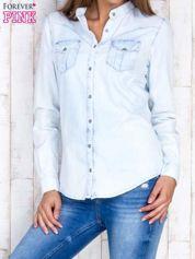 Jasnoniebieska damska koszula z jeansu