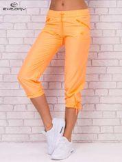 For Fitness Jasnopomarańczowe spodnie sportowe capri z wiązaniem