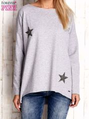 Jasnoszara bluza z błyszczącymi gwiazdkami