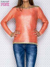 Koralowy sweter ze złotymi wstawkami