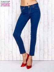 Niebieskie jeansowe spodnie skinny z kontrastowymi szwami