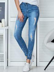Niebieskie jeansowe spodnie skinny z koronkowymi wstawkami