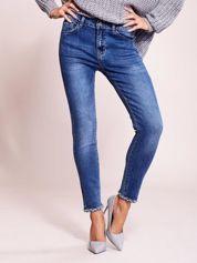 Niebieskie jeansowe spodnie z aplikacją