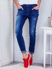 Niebieskie przecierane jeansy regular