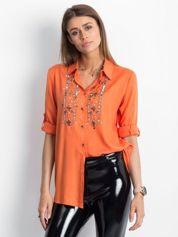 Pomarańczowa koszula z błyszczącą aplikacją