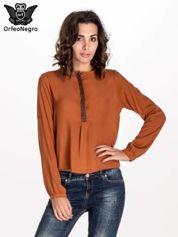 Pomarańczowa koszula ze wzorzystą wstawką w stylu etno
