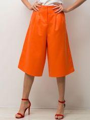 Pomarańczowe spodnie typu culottes