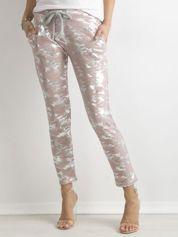 Różowe spodnie dresowe ze srebrnym printem