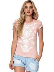 Różowy t-shirt z nadrukiem roślinnym