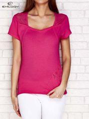 Różowy t-shirt z siatkową wstawką