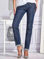 Spodnie jeansowe rurki z ozdobnymi suwakami granatowe