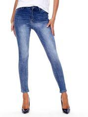 Spodnie niebieskie jeansowe z przetarciami